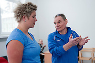 (L) Anita Wlodarczyk and (R) engineer Zbigniew Staniak (Institute of Sport) while her training session at Institute of Sport in Warsaw.<br /> Anita Wlodarczyk is a Polish hammer thrower and a former world record holder with 78.30 m.<br /> <br /> Poland, Warsaw, January 29, 2014<br /> <br /> Picture also available in RAW (NEF) or TIFF format on special request.<br /> <br /> For editorial use only. Any commercial or promotional use requires permission.<br /> <br /> Mandatory credit:<br /> Photo by © Adam Nurkiewicz / Mediasport