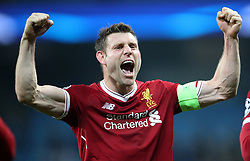 Liverpool's James Milner celebrates victory after the UEFA Champions League, Quarter Final at the Etihad Stadium, Manchester.