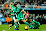 Craig Cathcart (#15) of Watford clears the ball as Matt Ritchie (#11) of Newcastle United loses possession on the edge of the penalty area during the Premier League match between Newcastle United and Watford at St. James's Park, Newcastle, England on 3 November 2018.