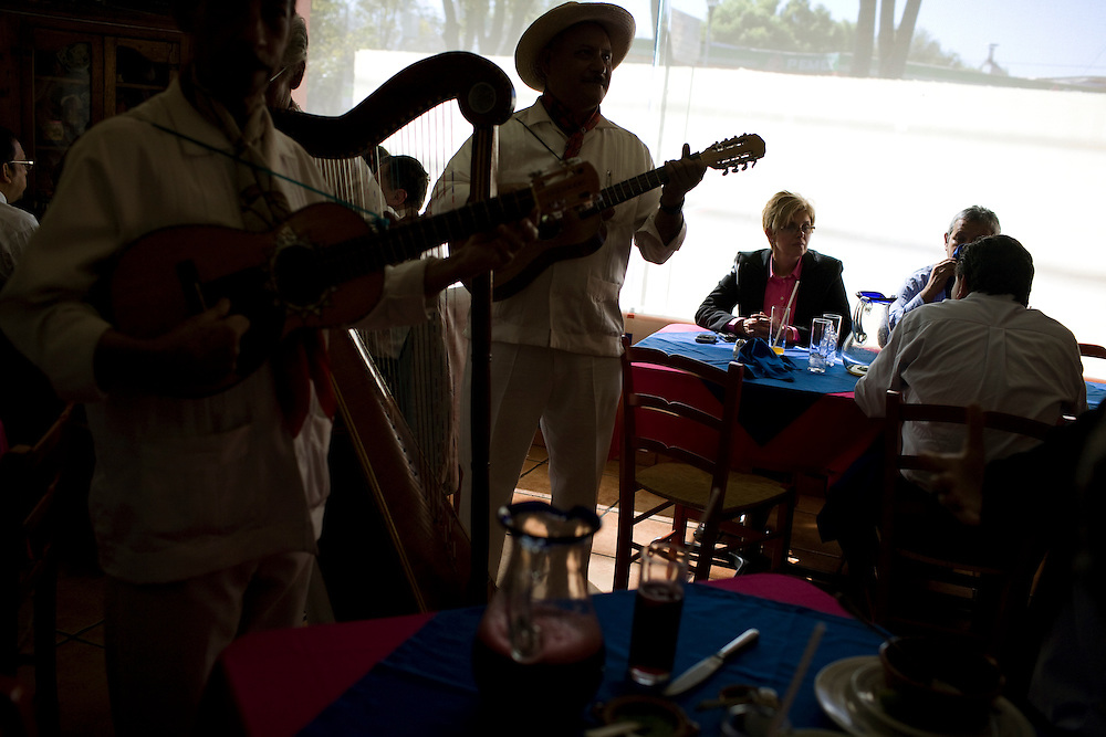 Musicians play for diners at El Bajio, a well known restaurant in Mexico City for traditional mexican cuisine.