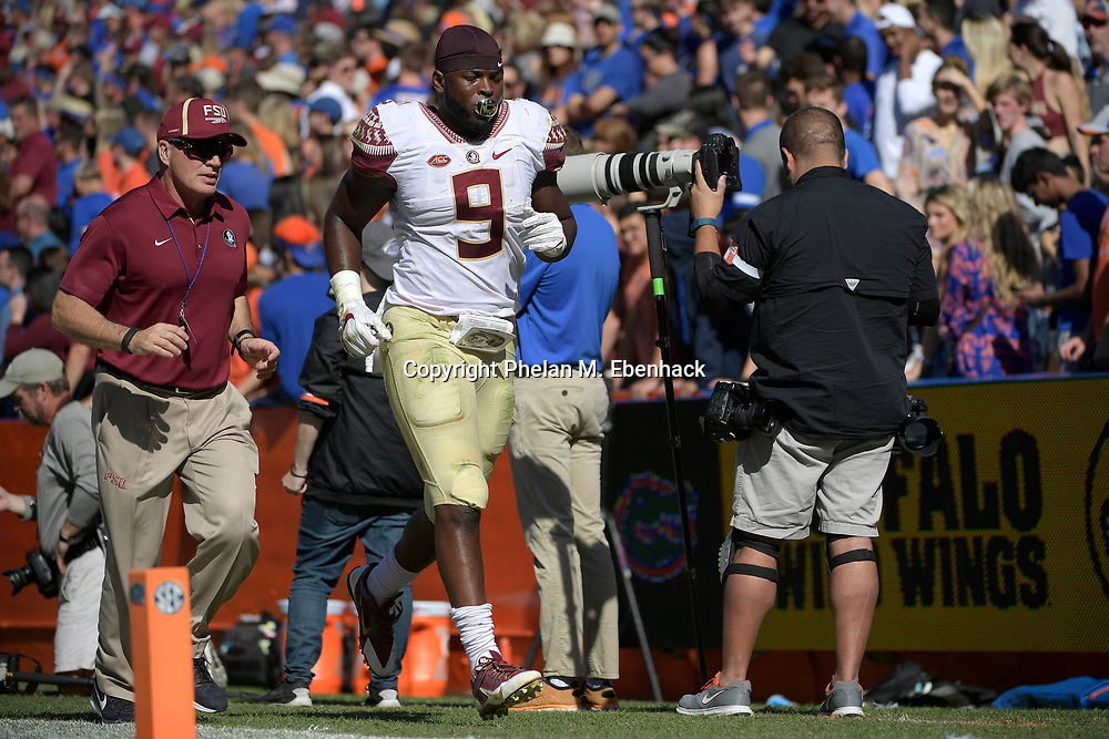 Florida State running back Jacques Patrick (9) jogs to the locker room during the first half of an NCAA college football game against Florida Saturday, Nov. 25, 2017, in Gainesville, Fla. (Photo by Phelan M. Ebenhack)