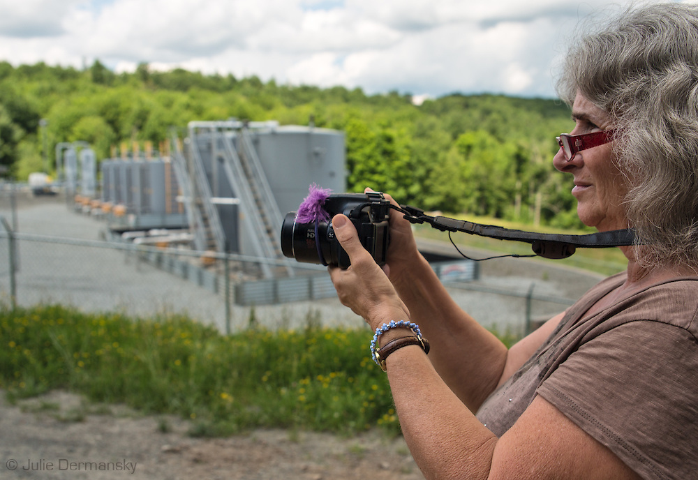 Vera Scroggins, anti fracking activist who gives tours of fracking industry sites in Susquehanna County PA, documents a compressor station where workers are on site dealing with a possible issue.