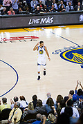 Golden State Warriors guard Stephen Curry (30) celebrates a basket against the Houston Rockets at Oracle Arena in Oakland, Calif., on October 17, 2017. (Stan Olszewski/Special to S.F. Examiner)