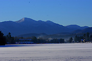 A view of the Sentinel Range of the Adirondack Mountain over frozen Mirror Lake in Lake Placid, N.Y.
