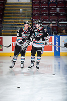KELOWNA, CANADA - OCTOBER 23: Cal Foote #25 and Lucas Johansen #7 of Kelowna Rockets warms up against the Prince George Cougars on October 23, 2015 at Prospera Place in Kelowna, British Columbia, Canada.  (Photo by Marissa Baecker/Shoot the Breeze)  *** Local Caption *** Cal Foote; Lucas Johansen;