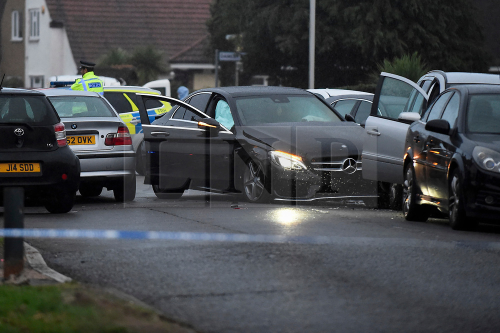 © Licensed to London News Pictures. 11/10/2018. LONDON, UK.  Police attend the scene where a black Mercedes has crashed into other vehicles on West Drayton Road in Hayes, West London.  It has been reported that the driver of the car was the victim of a drive-by shooting which took place earlier this afternoon.  Photo credit: Stephen Chung/LNP