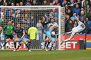 Sheffield Wednesday midfielder, on loan from Everton, Aidan McGeady (37)  blocks a shot from Huddersfield Town midfielder Joe Lolley (18)  during the Sky Bet Championship match between Huddersfield Town and Sheffield Wednesday at the John Smiths Stadium, Huddersfield, England on 2 April 2016. Photo by Simon Davies.