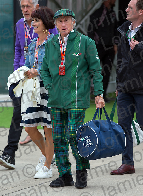 The 2017 Formula 1 Rolex British Grand Prix at Silverstone Circuit, Northamptonshire.<br /> <br /> Pictured: Sir Jackie Stewart, wearing his usual tartan trousers and cap, walks through the F1 paddock at Silverstone Circuit on qualifying day.<br /> <br /> Jamie Lorriman<br /> mail@jamielorriman.co.uk<br /> www.jamielorriman.co.uk<br /> +44 7718 900288