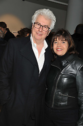 KEN FOLLETT and BARBARA FOLLETT at a private view of Bill Wyman - Reworked held at the Rook & Raven Gallery, 7 Rathbone Place, London W1 on 26th February 2013.