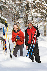A brother and sister wax their skis outside their cabin at the AMC's Little Lyford Pond Camps in Maine's Northern Forest.  Near Greenville.