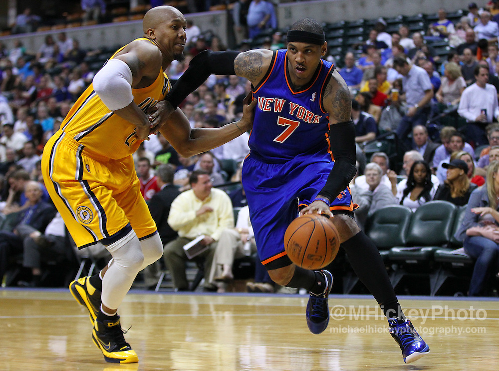 April 03, 2012; Indianapolis, IN, USA; New York Knicks small forward Carmelo Anthony (7) dribbles to the basket against Indiana Pacers power forward David West (21) at Bankers Life Fieldhouse. Indiana defeated New York 112-104. Mandatory credit: Michael Hickey-US PRESSWIRE