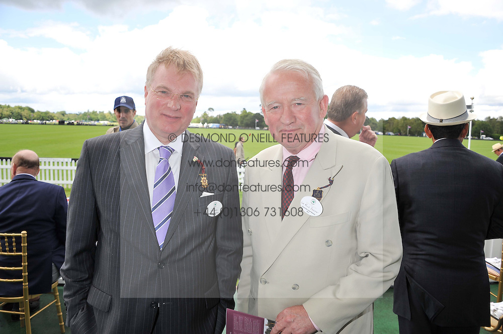 Left to right, PAUL RAYNER and COL.PAUL BELCHER former chairman of Guards Polo Club at Al Habtoor Royal Windsor Cup Final 2012 at Guards Polo Club, Berkshire on 24th June 2012.