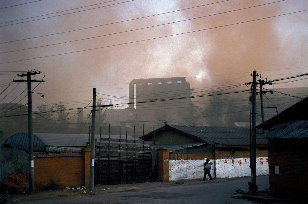 Environment. Factory without chimney spewing acrid pollution into the atmosphere in an industrial northern quarter of the city...From China [sur]real © Mark Henley..