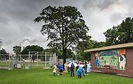 "Group on a ""toxic tour"" led by t.e.j.a.s. in Hartman Park across from Valero Houston Refinery. t.e.j.a.s. advocates for fenceline communities."