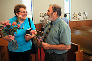 13 MAY 2012 -- FESTUS, Mo. -- The Rev. Bill Charlton (right) visits with the Rev. Ree Hudson of the Roman Catholic Women Priests (RCWP), following the final church service at the First Presbyterian Church in Festus Sunday, May 13, 2012. The congregation is merging with nearby Grace Presbyterian Church in neighboring Crystal City. In recent years, as membership in  First Presbyterian dwindled, the church has shared its worship space with the Rev. Hudson's congregation and with the Twin Cities Christian Church. Photo © copyright 2012 Sid Hastings.