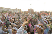 Color Runners cheer on a dance competition on the main stage outside the finish line. Photos by Elizabeth Held