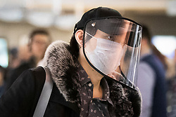 © Licensed to London News Pictures. 11/03/2020. London, UK. A commuter at Westminster Station, wearing a medical mask and a visor. New cases of the COVID-19 strain of Coronavirus are being reported daily as the government outlines it's plans for controlling the outbreak. Photo credit: George Cracknell Wright/LNP