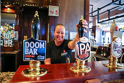 © Licensed to London News Pictures. 03/07/2020. London, UK. LINDY, the Bar Manager behind the counter in The Toll Gate, a Wetherspoon pub in north London as the pub prepares to reopen on 4 July, the 'Super Saturday'. Pubs across the UK closed on 23 March following the coronavirus lockdown. As COVID-19 lockdown restrictions are eased, pubs will reopen on Saturday 4 July. Some pubs are planning to reopen from 6am. Photo credit: Dinendra Haria/LNP