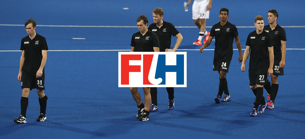 RIO DE JANEIRO, BRAZIL - AUGUST 14:  New Zealand players look dejected  after conceding a last minute goal as they are defeated 3-2 during the Men's hockey quarter final match between the Germany and New Zealand on Day 9 of the Rio 2016 Olympic Games at the Olympic Hockey Centre on August 14, 2016 in Rio de Janeiro, Brazil.  (Photo by David Rogers/Getty Images)