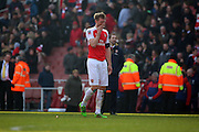 Arsenal defender and captain, Per Mertesacker (4) after the loss during the The FA Cup Quarter Final match between Arsenal and Watford at the Emirates Stadium, London, England on 13 March 2016. Photo by Matthew Redman.