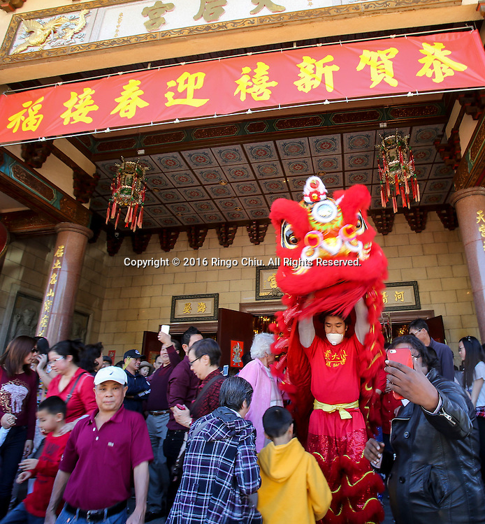 A lion dancer performs at the Thien Hau temple to celebrate the first day of the Chinese Lunar New Year, the Year of the Monkey, on Monday February 8, 2016, in Los Angeles.(Photo by Ringo Chiu/PHOTOFORMULA.com)<br /> <br /> Usage Notes: This content is intended for editorial use only. For other uses, additional clearances may be required.