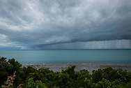 Dramatic storm clouds and rain viewed from a hill overlooking the Gulf of Thailand on Ko Phangan, Thailand