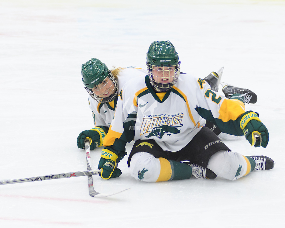 4th year forward Kylee Kupper (21) of the Regina Cougars & 3rd year forward Emma Waldenberger (9) of the Regina Cougars in action during the Women's Hockey Home Game on October 15 at Co-operators arena. Credit: Arthur Ward/Arthur Images
