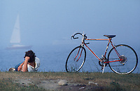 man relaxing on the shore -photograph by Owen Franken