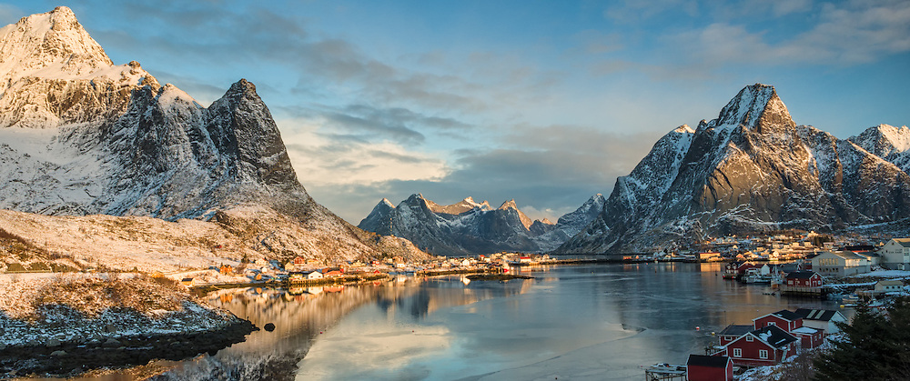 Fishing village of Reine on Reinefjord in Norway with Olstind Mountain in the background.