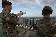 LtoR: Major Mike Keighley  and Private Oli Wilkinson look out over the Manila skyline from the roof of the Discovery Suites Hotel.<br /> 24/04/2015.<br /> <br /> Credit should read: Cpl Mark Larner RY<br /> <br /> Exercise Civil Bridge is being conducted by elements of 77 Brigade &ndash; a specialist British military unit that is working alongside the government and disaster relief organisations as part of an annual overseas training exercise. <br /> <br /> Their mission during the two-week deployment will be to look at examples of the existing Philippine earthquake contingency response plans and, working with Philippine colleagues, make suggestions that will help save lives by enhancing the country&rsquo;s ability to respond to an earthquake in an urban setting.