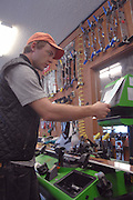 Ski technician Dillon Ott works on the binding adjustment of a customers skis in the Nubs Nob ski area's demo and repair shop.   Both Nubs Nob and neighboring Boyne Highlands will be open for skiing this weekend.