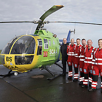 FREE TO USE PHOTOGRAPH....30.10.15<br /> Scotland's Charity Air Ambulance (SCAA) unveiled it's new helicopter at Perth airport this morning a EC135 T2i (pictured) which replaces the Bolkow 105 helicopter which is retiring from service. The new helicopter will increase speed, range, endurance and payload, allow SCAA to fly at night and in cloud. Pictured from left, Chief Pilot Russell Myles with the Paramedic team Lead Paramedic John Pritchard, Mark Tynan, Craig McDonald, John Salmond and Julia Barnes<br /> for further info please contact Maureen Young on 07778 779000<br /> Picture by Graeme Hart.<br /> Copyright Perthshire Picture Agency<br /> Tel: 01738 623350  Mobile: 07990 594431