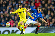 Manu Trigueros (#14) of Villarreal CF holds off Jonathon Flanagan (#15) of Rangers FC during the Europa League group stage match between Rangers FC and Villareal CF at Ibrox, Glasgow, Scotland on 29 November 2018.