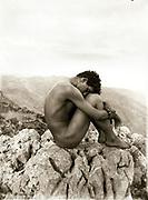 Wilhelm von Gloeden (1856-1931), Photographer. 'Caino'. Around 1902. A portrait of a nude male on rocks.