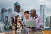 Teacher Juan Garner talks with students on the green roof at Carnegie Vanguard High School, September 18, 2015.