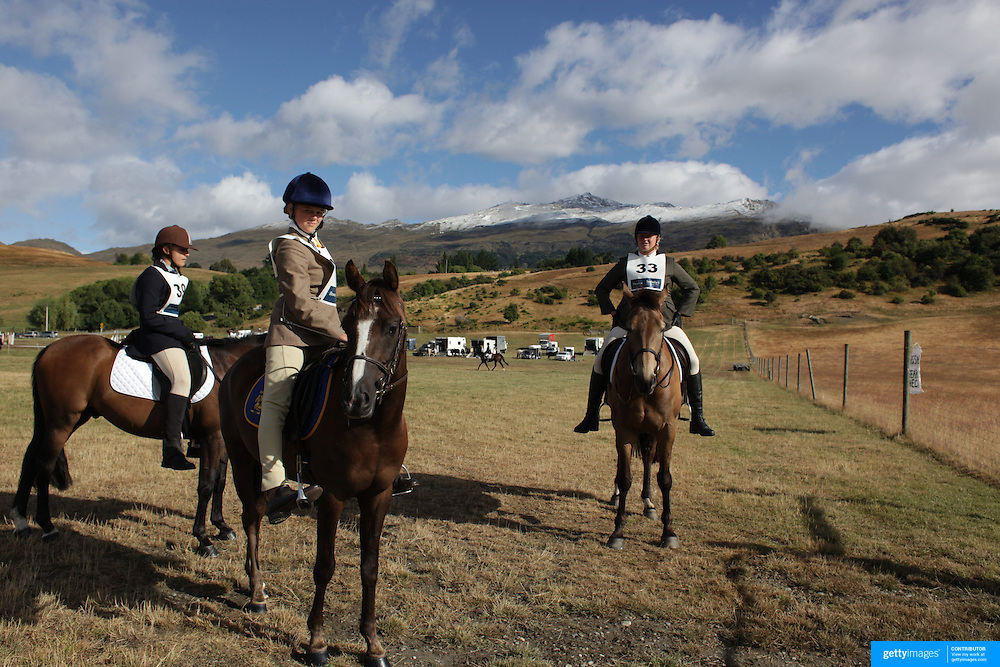 ALex Forsyth (centre)  riding Nobel Secret Wish prepares for the Dressage event at the Wakatipu One Day Horse Trials,  Queenstown, Otago, New Zealand. 15th January 2012. Photo Tim Clayton