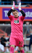 Plymouth Argyle goalkeeper Luke McCormick applauds the crowd during the Sky Bet League 2 match between Cheltenham Town and Plymouth Argyle at Whaddon Road, Cheltenham, England on 28 March 2015. Photo by Alan Franklin.