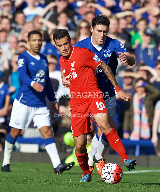 LIVERPOOL, ENGLAND - Sunday, October 4, 2015: Liverpool's Philippe Coutinho Correia in action against Everton's Gareth Barry during the Premier League match at Goodison Park, the 225th Merseyside Derby. (Pic by David Rawcliffe/Propaganda)