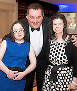 Deirdre McGinley, salthill and Aine Lynch Renmore with MC Ollie Turner  at the Ability West Best Buddy Ball and award night at the Menlo Park Hotel Galway. Photo:Andrew Downes.