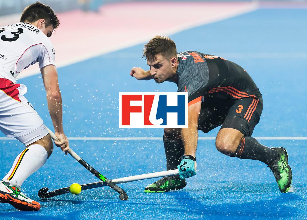 BHUBANESWAR - Tristan Algera (Ned) met links Arthur De Sloover (Bel)  tijdens de Hockey World League Final wedstrijd Belgie-Nederland (3-0).   COPYRIGHT KOEN SUYK