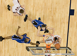 Virginia's Jason Cain (33) scores two of his six points against Duke.  The University of Virginia Cavaliers beat the #8 ranked Duke University Blue Devils 68-66 in overtime at the John Paul Jones Arena in Charlottesville, VA on February 1, 2007...