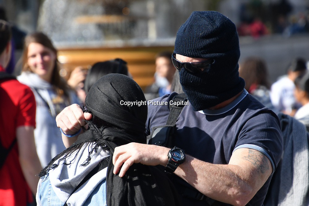 Just over about 20 far-rights Islamophobia demonstration anti-Burka mock with wearing Burka in Trafalgar square, London, UK. 29 September 2018.
