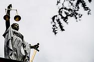 rotterdam - In de aanloop naar de Tweede Kamerverkiezingen begin volgend jaar gaat het Openbaar Ministerie (OM) de sociale media extra in de gaten houden op beledigen en discrimineren van politici.  Een beeld van Vrouwe Justitia op een rechtbank advocaat advocaat-generaal afbeelding afweging arbitrage arrest arron arrondissement beeld beklaagde beroep bewijslas blinddoek blinddoek exterieur gerechtsgebouw justitia criminaliteit de dwaling eerlijk eerlijkheid exterieur gelijkheid gerechtelijke gerechtelijke dwaling gerechtigheid gerechtigheid | justitia gerechtsgebouw gerechtshof godin griekse holland justitia justitie justitieel kortgeding kunstwerk macht misdaad misdrijf nederland onbevooroordeeld personificatie proces recht rechtbank rechters rechtsgang rechtspraak rechtstaat romeinse rotterdam schaal standbeeld symboliek symbolisch symbool tegenhangster trefwoorden uitspraak vertrouwen vonnis voor vrouwe vrouwe justitia vrouwe justitia voor de rechtbank weegschaal weging zwaarddwaling | gerechtelijke | gerechtelijke dwaling | gerechtigheid | justitia | justitie | recht | rechtspraak | uitspraak | vonnis | vrouwe | vrouwe 2016 | afbeelding | afweging | beeld | blinddoek | criminaliteit | eerlijk | eerlijkheid | gelijkheid | gerechtigheid | gerechtshof | godin | griekse | holland | justitia | justitie | kunstwerk | misdaad | misdrijf | nederland | onbevooroordeeld | personificatie | proces | recht | rechtbank | rechtsgang | rechtspraak | rechtstaat | romeinse | standbeeld | symboliek | symbolisch | symbool | tegenhangster | themis | vertrouwen | vonnis | vrouwe | weegschaal | zwaardcopyright robin utrecht