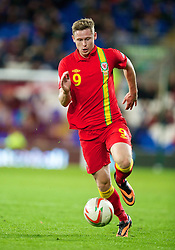 CARDIFF, WALES - Friday, October 11, 2013: Wales' Simon Church in action against Macedonia during the 2014 FIFA World Cup Brazil Qualifying Group A match at the Cardiff City Stadium. (Pic by David Rawcliffe/Propaganda)