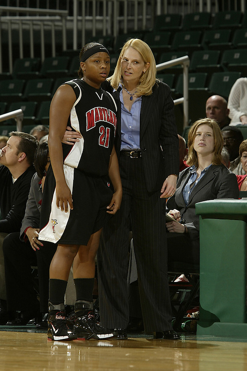 University of Maryland head coach Brenda Frese chats with guard Ashleigh Newman during the Terrapins 111-53 victory over the Miami Hurricanes on January 10, 2007 at the BankUnited Center in Coral Gables, Florida.