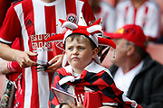A young fan of Sheffield United during the Premier League match between Sheffield United and Crystal Palace at Bramall Lane, Sheffield, England on 18 August 2019.