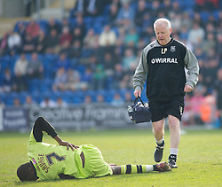 COLCHESTER, ENGLAND - Saturday, April 24, 2010: Tranmere Rovers' Manager and Physio Les Parry comes on to treat the injured Bas Savage during the Football League One match at the Western Community Stadium. (Photo by Gareth Davies/Propaganda)