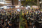 CHINA, Hong Kong: 10 August 2019 <br /> Pro-democracy protesters confront an outnumbered amount of riot police in Tsim Sha Tsui district of Hong Kong. Demonstrators have taken to the streets of Hong Kong in protest of a controversial extradition bill since 9th of June which has resulted in several violent clashes.<br /> Rick Findler / Story Picture Agency