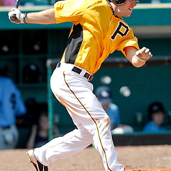 February 25, 2011; Bradenton, FL, USA; Pittsburgh Pirates right fielder John Bowker (14) during a spring training exhibition game against the State College of Florida Manatees at McKechnie Field. The Pirates defeated the Manatees 21-1. Mandatory Credit: Derick E. Hingle
