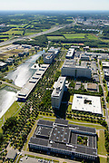 Nederland, Noord-Brabant, Eindhoven, 23-08-2016; High Tech Campus Eindhoven, onderdeel Brainport Eindhoven. Het terrein van het voormalige 'NatLab' het Philips Natuurkundig Laboratorium huisvest tegenwoordig allerlei hightech bedrijven, waaronder Philips Research, Atos Origin, ASML, IBM, Fluxxion, NXP. Het langwerpige gebouw langs het water is The Strip (facilitair gebouw, gemeenschappelijke voorzieningen, conferentiecentrum). <br /> High Tech Campus Eindhoven. The site of the former 'NatLab 'the Philips Physics Laboratory today houses many hightecbedrijven, including Philips Research, Atos Origin, ASML, IBM, Fluxxion, NXP. Part of Brainport Eindhoven.<br /> <br /> luchtfoto (toeslag op standard tarieven);<br /> aerial photo (additional fee required);<br /> copyright foto/photo Siebe Swart